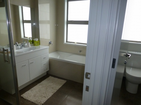 Private guest bathroom and separate toilet
