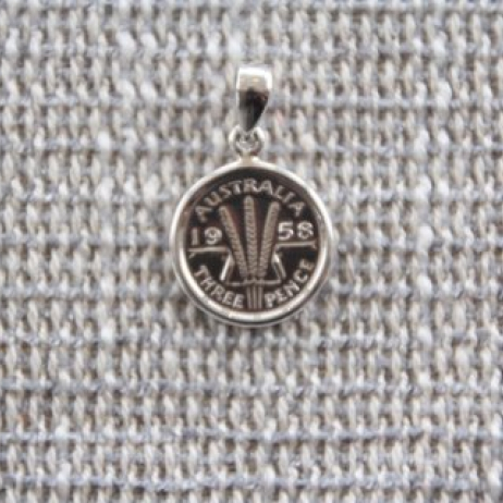 Threepence pendant or charm (dated before 1964)