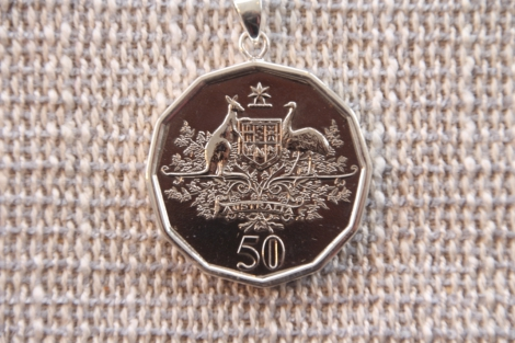 Octagonal 50c piece encased in silver