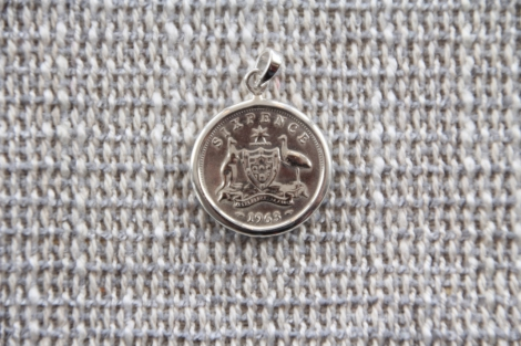 Sterling silver encased sixpence (Pre 1964)