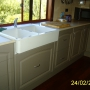 CABINETS CUSTOM MADE TO SUIT THE FARMERS SINK.