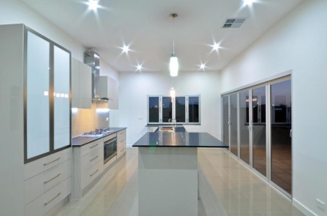 STRIKING KITCHEN AND ENTERTAINMENT AREA.