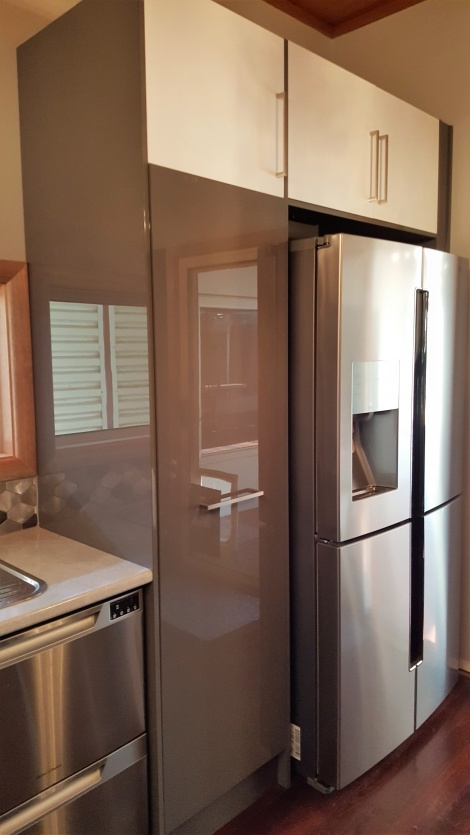 BUILT IN FRIDGE AND CABINETS WITH DIFFERENT COLOURED DOORS