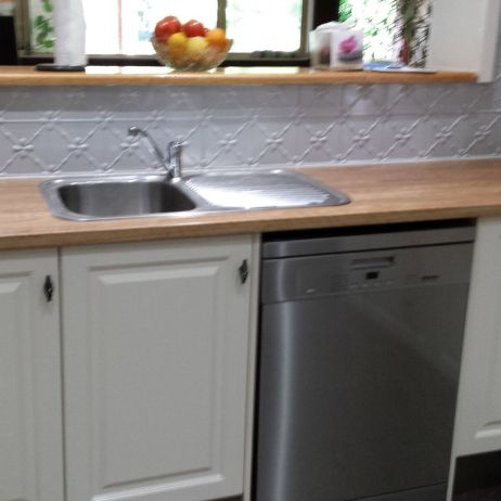 A VERY CLASSEY LOOK WITH PRESSED TIN BACKSPLASH AND SOLID TIMBER BENCH TOPS