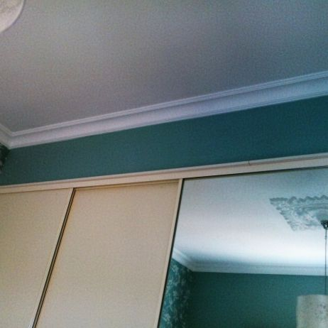 BUILT IN WARDROBES WITH BULKHEAD ABOVE AND MATCHING CORNICE.