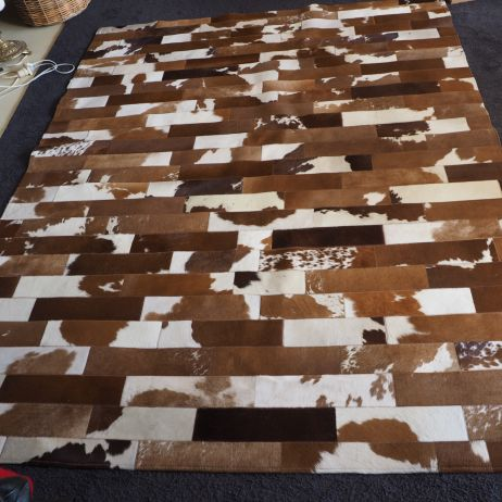 A modern twist on a country classic - a Subway Tile Cowhide Rug