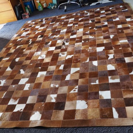 Measuring a large 2.25 x 2.80 metres 10cm patch cowhide rug
