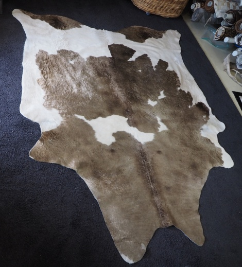 Mach/40:  GLORIOUS WAVY LIGHT REFLECTING BRONZE COVERS A SILKY WHITE BASE - A BEAUTIFUL COWHIDE RUG