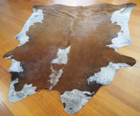 BRW/9: A THICK AND BEAUTIFUL COAT- A GORGEOUS BASICALLY BROWN AND WHITE WINTER COATED COWHIDE RUG