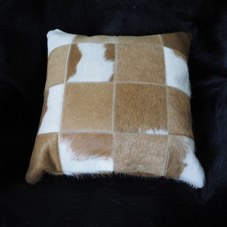 A GORGEOUS JERSEY CARAMEL AND WHITE COWHIDE CUSHION