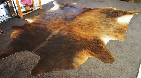 A Darkened Neck and Sultry tones  - A Big and Beautiful Cowhide Rug