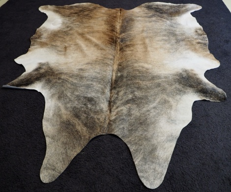 U3/121; Soft Earthen Tones Grace this Beautiful Cowhide Rug