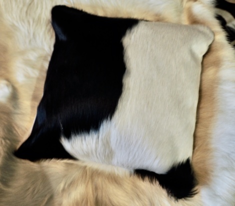 BW40/8: A Lovely Long Haired Black on White Cowhide Cushion