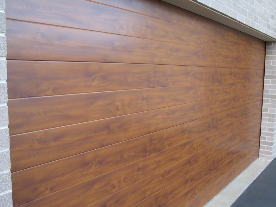 Same warmth as western red cedar at a fraction of the for Cedar wood garage doors price