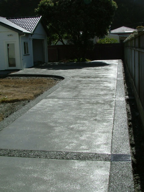 Sponge Finish Concrete With Exposed Aggregate Edging