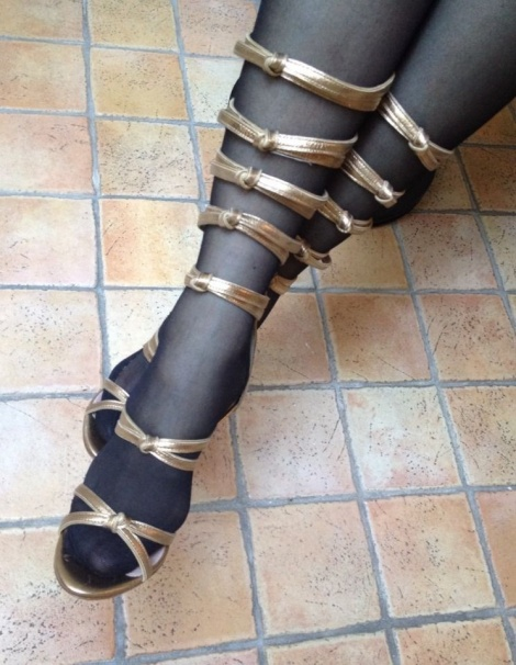 Gold leather gladiator heels