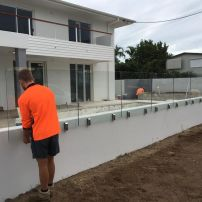 Carl and Kyle , installing Frameless Glass with Stainless Steel 2205 Polished Vertical Clamps