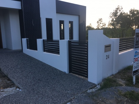 Slatted Aluminium Powder coated in Monument with single pedestrian Gate