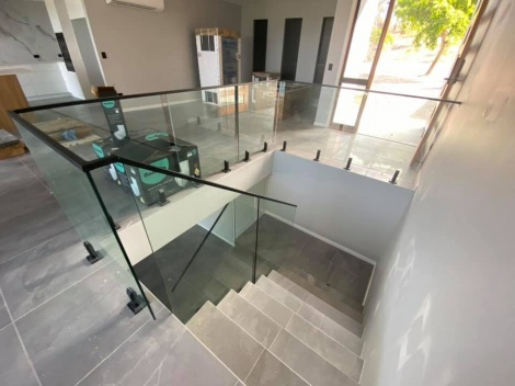 Glass Balustrade Raked Stair Panels Black core drilled spigots