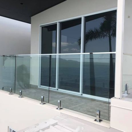 Frameless Glass Balustrade with Core drilled stainless steel spigots and Nano Handrail