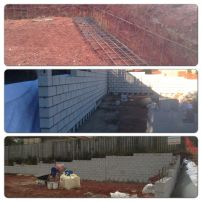 Re-enforced foundation and retaining wall